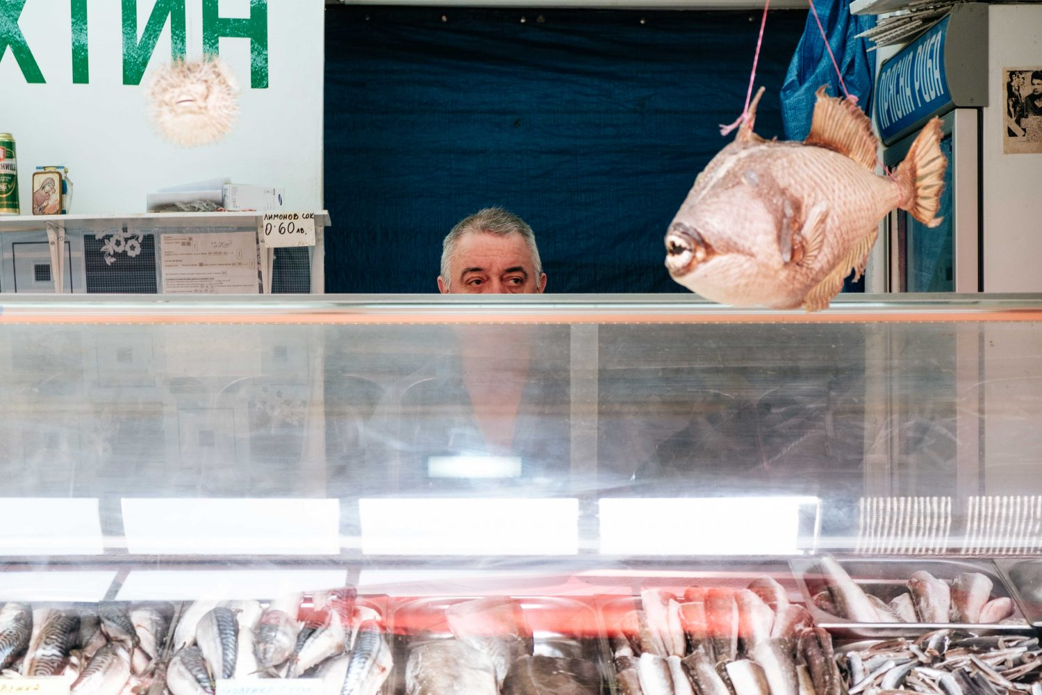A fishmonger at the Ladies Market
