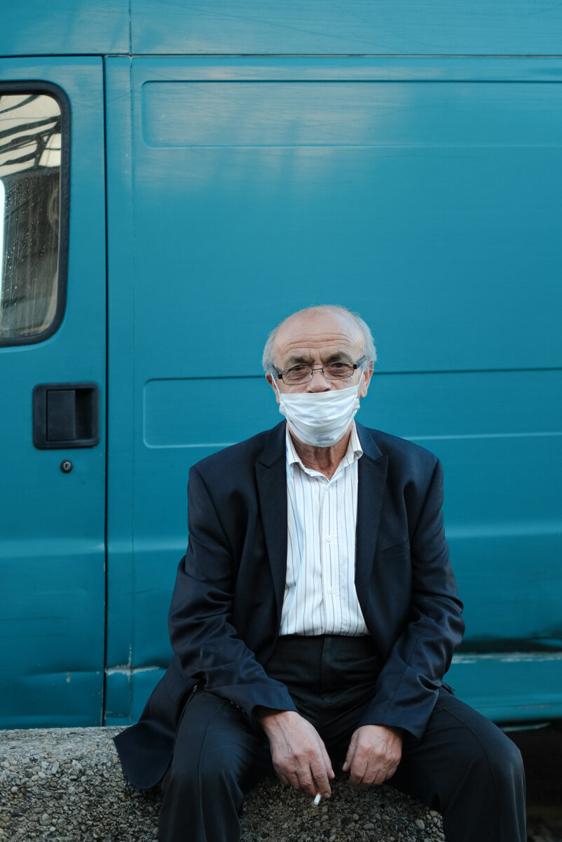 Olga Serjantu_A man sitting in front of a vehicle